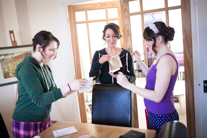 bride & bridesmaids opening gifts