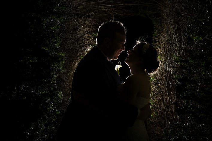 backlit portrait of bride and groom